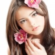 Stock Photo: Beautiful woman with orchid