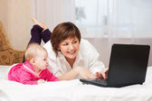Mother and baby with notebook — Stock Photo