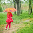 Royalty-Free Stock Photo: Little girl with umbrella outdoor