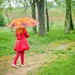 Little girl with umbrella outdoor — Stock Photo