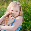 Royalty-Free Stock Photo: Smile girl with cat outdoor