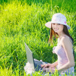 Smile girl using laptop on green meadow — Stock Photo #10468924