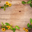 Royalty-Free Stock Photo: Yellow flowers on wooden background