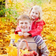Brother and sister in autumn garden — Stock Photo