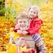 Brother and sister in autumn garden — Stock fotografie