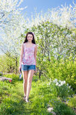 Beautiful girl in garden — Stock Photo