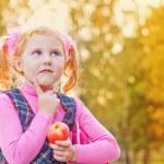 Scoolgirl with apple outdoor — Stock Photo #10470124