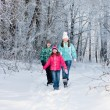 Family in winter park — Stock Photo #10470295