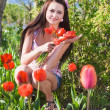Stock Photo: Beautiful girl with flowers in garden