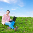 Men with laptop outdoor — Stock Photo