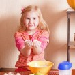 Stock Photo: Little girl in the kitchen