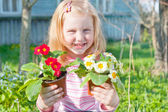 Girl with flowers outdoor — Stock Photo