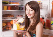 Girl with cake on kitchen — Stock Photo