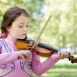 Girl with violin outdoor — Stock Photo #8367818