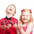 Children with grapes — Stock Photo