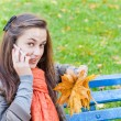 Girl with phone in autumn park — Stock Photo