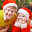 Stock Photo: Children on background christmas tree