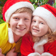 Children on background christmas tree — Stock Photo