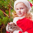 Little girl on background chtristmas tree — Stock fotografie