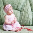 Little girl on the sofa — Stock Photo