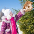 Little girl in winter park — Stock Photo