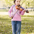 Girl with violin outdoor — Stock Photo