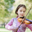 Girl with violin outdoor — Stock Photo #8368549