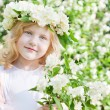 Stock Photo: Little girl with flowers