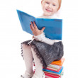 Little girl with book — Stock Photo #8369277