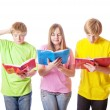 Stock Photo: Teenagers with books isolated on white