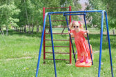 Happy little girl on swing — Stock Photo