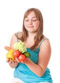 Girl holding vegetables isolated on white — Stock Photo