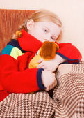 Ill girl with toy — Stock Photo
