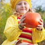 Girl with pumpkin outdoor — Stock Photo