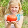 Girl with tomato — Stock Photo