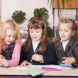 Schoolgirls in classroom — Stock Photo #9045263