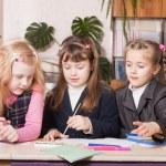 Schoolgirls in classroom — Stock Photo