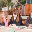 Schoolgirls in classroom — Stock Photo