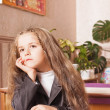Stock Photo: Girl in school at the desk