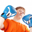 Teenager in boxing gloves, white background — Stock Photo