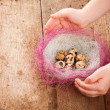 Easter eggs in children's hands on wooden background — Stock Photo