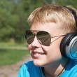Boy listening to music — Stock Photo