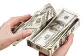 Hands open a box with money — Stockfoto