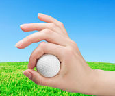 Hand holds a ball for game in golf — Stock Photo