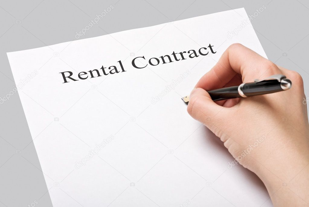 Sign a rental contract on a gray background — Stock Photo #10547680