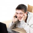 Teenager with notebook and phone — Stock Photo