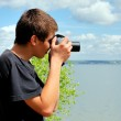 Young man with camera — Stock Photo #10384632