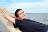 Young man at seaside — Stock Photo