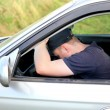 Man fall asleep in the car - Stock Photo