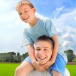 Stock Photo: Young man and boy